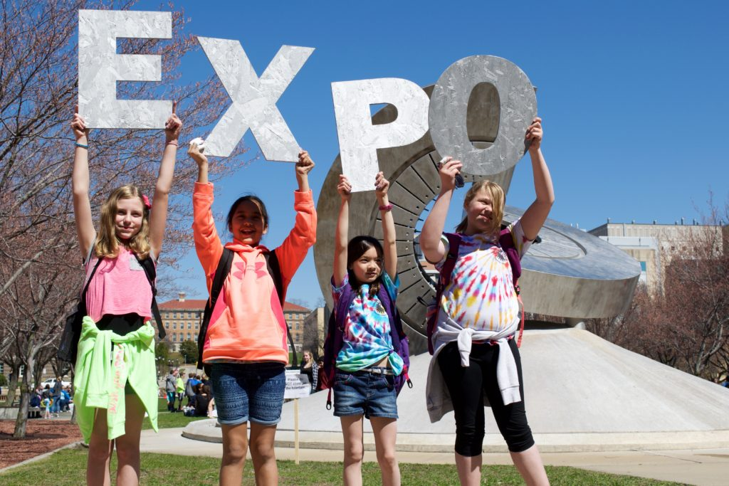 Students pose with EXPO letters photo